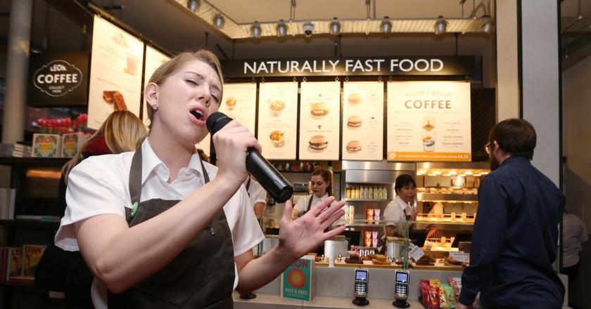 A staff member singing at LEON's new West End restaurant | © Joe Pepler / REX / Shutterstock