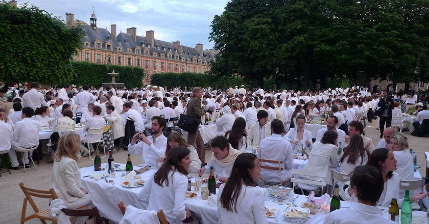 """White dinners are a chic affair where everyone brings a picnic and tables and has a """"pop up"""" dinner 