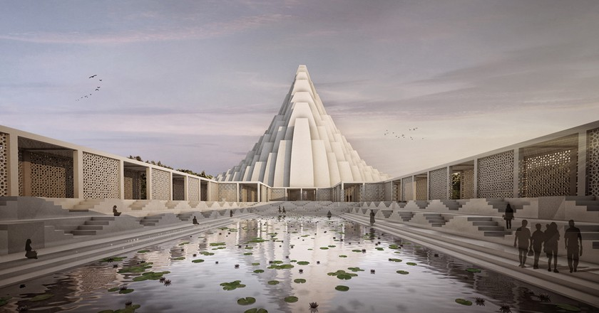 ISKCON Temple reflecting in the holy pond © Sanjay Puri Architects