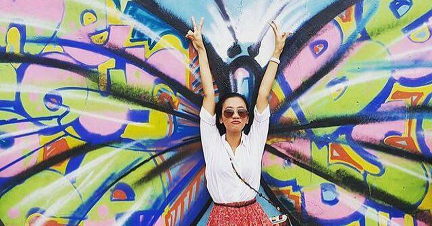 """A """"Fly"""" Pose in Front of Mou Awudu's Street Graffiti 