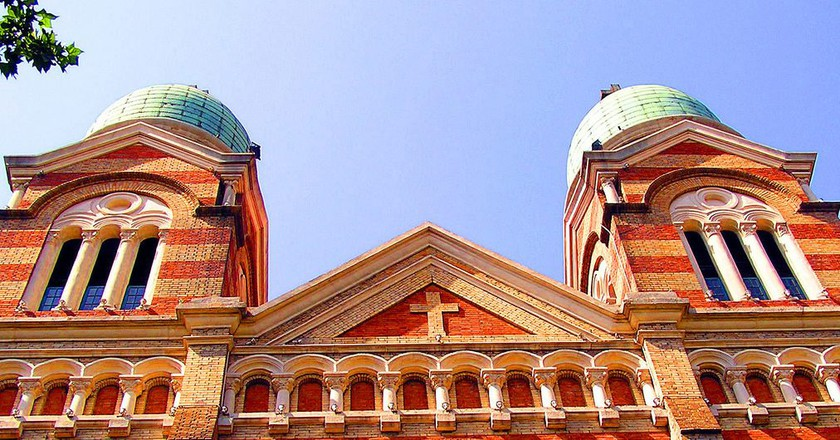 """<a href""""https://www.flickr.com/photos/gillpenney/2218747532/"""">TianjinCatholicCathedral   Gil Penney / Flickr</a>"""