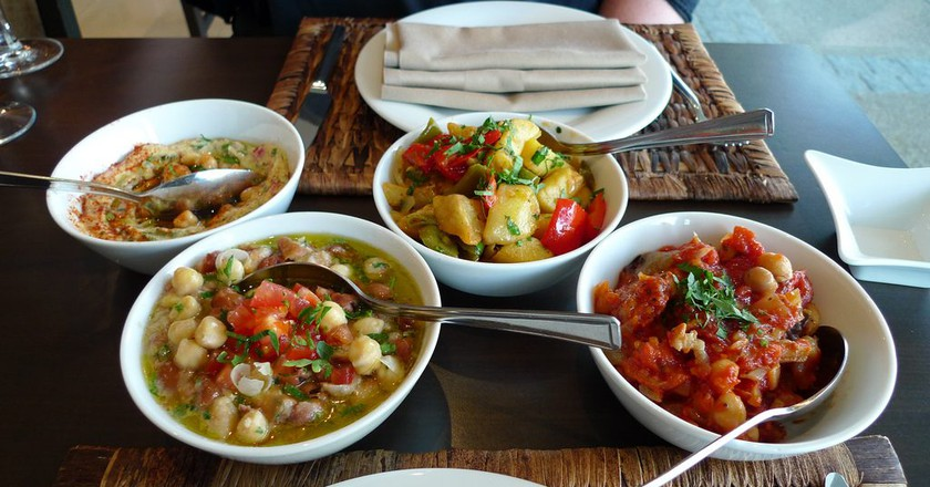 "<a href=""https://www.flickr.com/photos/55935853@N00/3639283205/"" target=""_blank"" rel=""noopener noreferrer"">A selection of different Lebanese mezza dishes, L-R: hommos, foul moudamas, batata harra, and moussaka 
