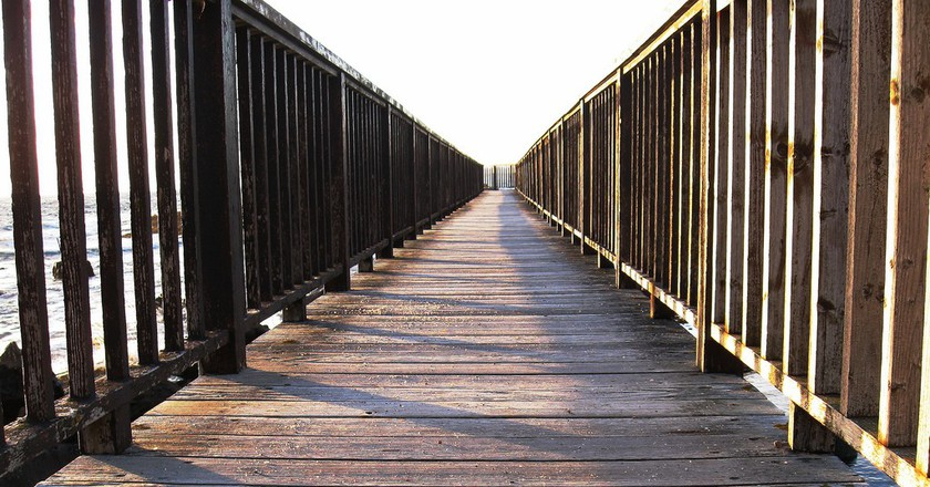 Bridge on Ballycastle Beach   © Nick/ Flickr