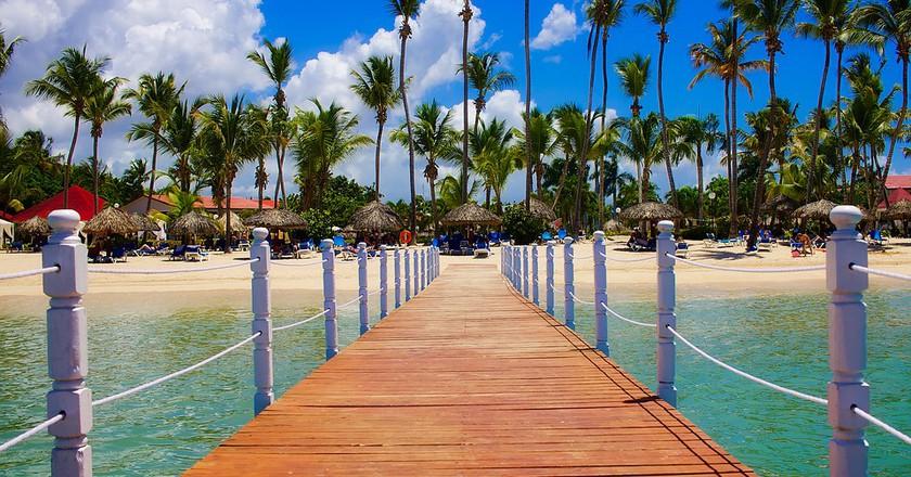"""<a href = """"https://pixabay.com/en/dominican-republic-tropics-palms-1884286/""""> Dominican Republic   © tpsdave/Pixabay"""