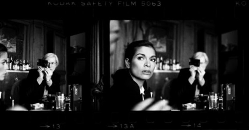 Harry Benson, Andy Warhol and Bianca Jagger at The Factory, 1977. Infused dyes sublimated on aluminum, 36 × 78 in (91.4 × 198.1 cm). Signed on recto. Image courtesy Holden Luntz Gallery, Palm Beach, Florida