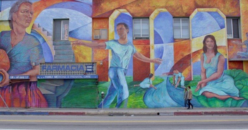 Mickey and Gus pass a mural on Echo Park Avenue off Sunset Boulevard|Courtesy of Netflix