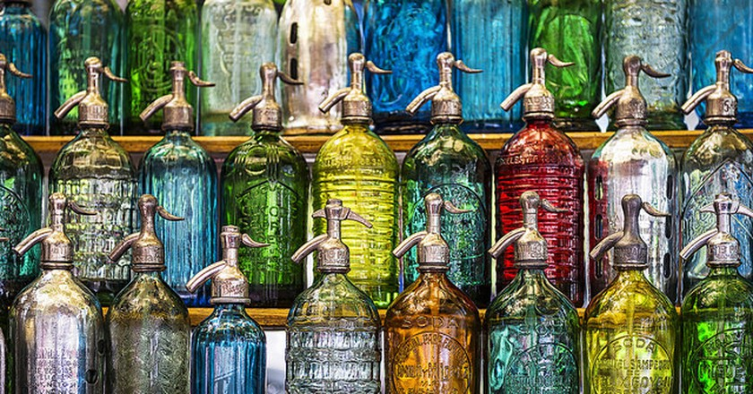 Antique soda bottles for sale at the San Telmo Market, Buenos Aires   © Travelbusy.com / Flickr