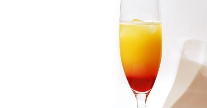 A Tequila Sunrise cocktail | © Benjamin Nussbaum/Flickr