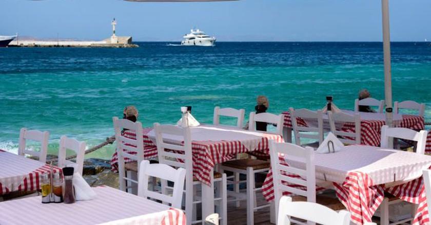 Seaside dining in Greece |  © Joe deSousa/Flickr