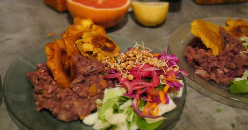 Refried beans, plantains and salad from the Latin menu at Jueves A La Mesa   Courtesy of Jueves A La Mesa