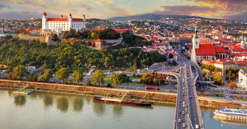 Aerial view of Bratislava, Slovakia, at sunset   © TTstudio/Shutterstock
