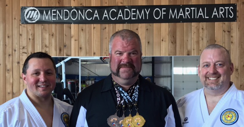 Shawn Buller (center) won four medals at the 2017 U.S. National Sumo Championships. | Courtesy of Shawn Buller