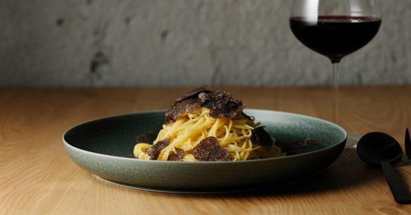 Fresh truffle pasta and red wine | Courtesy of OUT