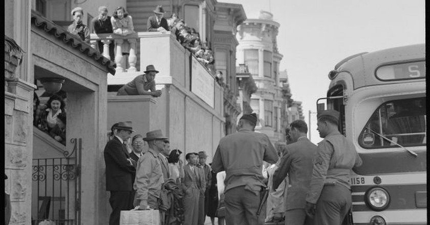 """<a href=""""https://www.flickr.com/photos/anchoreditions/31415654360/"""" target=""""_blank"""" rel=""""noopener noreferrer"""">Evacuation of Japanese from Japantown   Dorothea Lange for Anchor Editions / Flickr</a>"""
