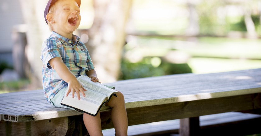 """<a href = """"https://www.pexels.com/photo/laughing-boy-sitting-on-table-during-daytime-160191/""""> Laughing Boy   © Unsplash/Pexels"""