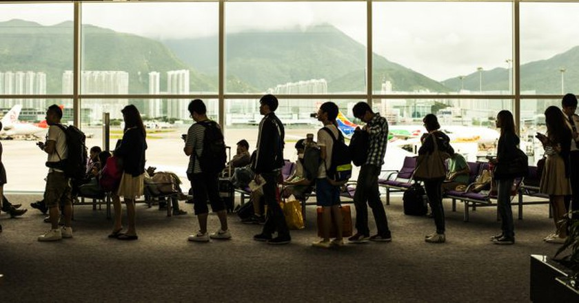 People waiting to board a plane   © Shutterstock