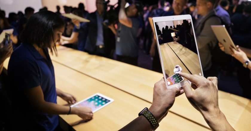 Attendees of WWDC try out the new ARKit, bringing high-quality AR experiences to iPhone and iPad.