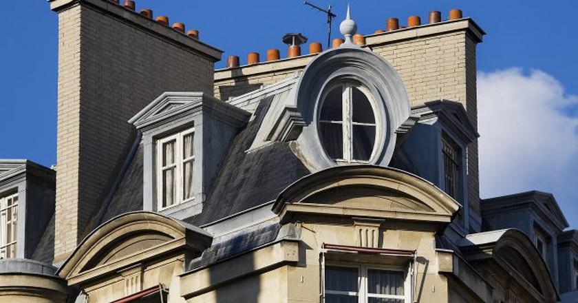 "<a href = ""https://commons.wikimedia.org/wiki/File:Paris_-_Rooftops_in_Paris_-_3052.jpg""> Rooftops in Paris │© Jorge Royan/Wikimedia Commons"