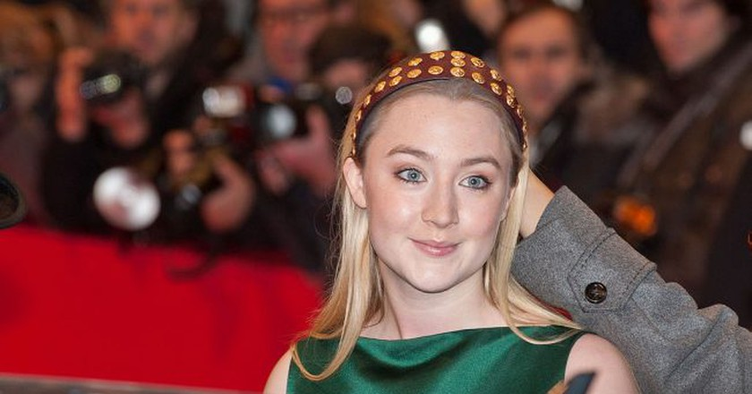Saoirse Ronan at premiere of The Grand Budapest Hotel (2014) | © Siebbi / Wikimedia Commons</a>