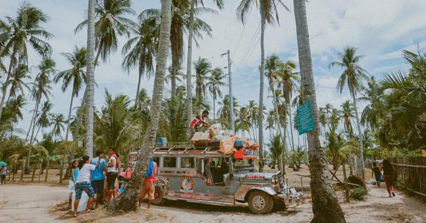 "<a href=""https://unsplash.com/photos/MGUC3WkLkWM"" target=""_blank"" rel=""noopener noreferrer"">Jeepney Ride | Toa Heftiba / Unsplash</a>"