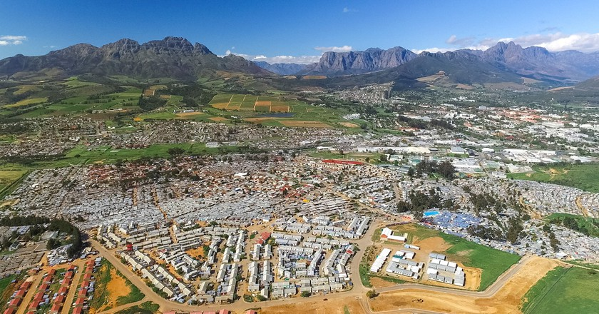 """<a href=""""http://www.unequalscenes.com"""">Aerial view of Kayamandi and Stellenbosch 