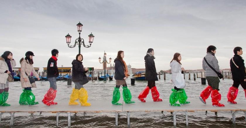 Tour group walks through high water   Courtesy of Federico Sutera