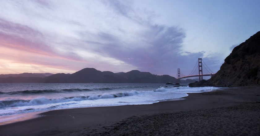 "<a href=""https://www.flickr.com/photos/76771463@N02/14115848399/"" target=""_blank"" rel=""noopener noreferrer"">Sunset at Baker Beach and the Golden Gate Bridge San Francisco   © Katie Haugland Bowen / Flickr</a>"