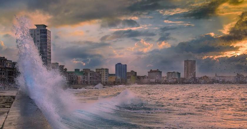 Waves crash against El Malecon in Havana