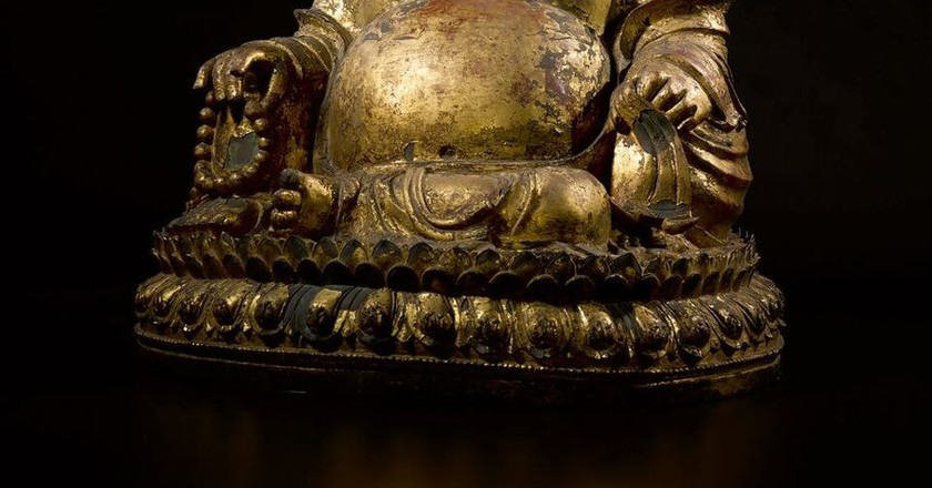 An Exceptionally Rare And Large Gilt-Lacquered Bronze Figure Of Budai Date Jiajing 4th Year, Corresponding To 1525 | Courtesy of Sotheby's New York