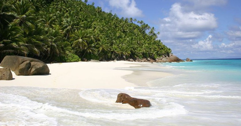 """<a href=""""https://commons.wikimedia.org/wiki/File:Anse_Victorin,_Fregate_Island,_Seychelles_-_panoramio.jpg"""">A headless woman supposedly roams the coast of Fregate Island keeping the shores safe.   © Jlexa/Wikimedia Commons </a>"""