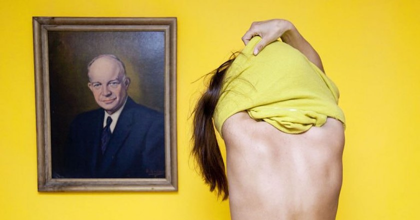 """In Ohio, it is illegal to disrobe in front of a portrait of a man."" From I Fought the Law: Photographs by Olivia Locher of the Strangest Laws from Each of the 50 States, published by Chronicle Books 2017 