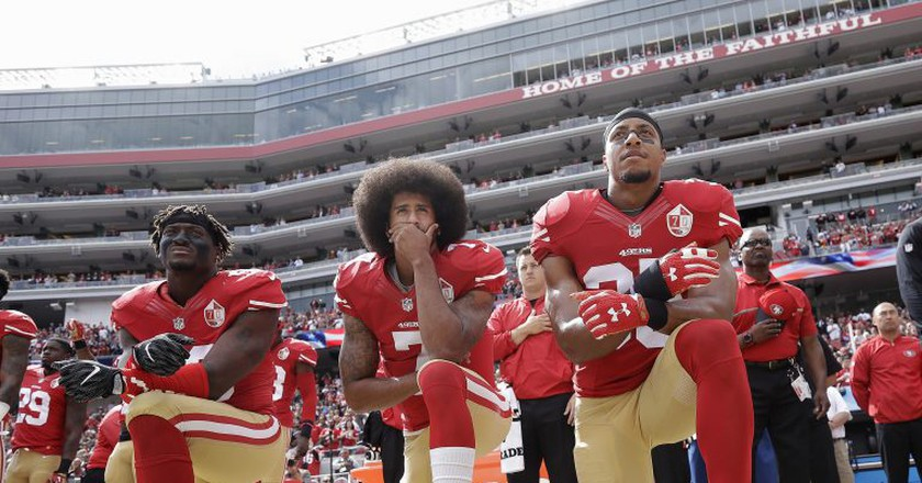Colin Kaepernick (center) kneels during the national anthem prior to a 2016 NFL game