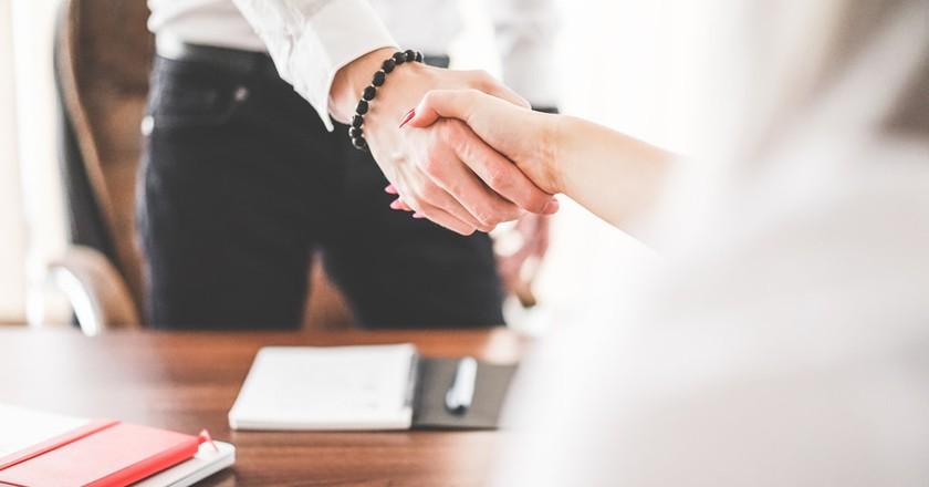A business handshake | © perzon seo / Flickr