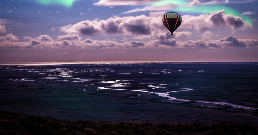 Hot air balloon over Iceland with Northern Lights in the sky   © Andres Nieto Porras