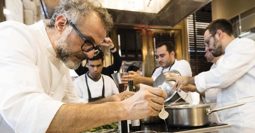 Chef Massimo Bottura plates dishes at 2016's Identita Golose NYC   courtesy of Identita Golose