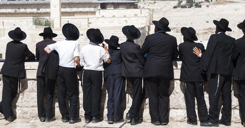 Orthodox Jews in front of the Western Wall, Jerusalem   © Nina Mikryukova/Shutterstock