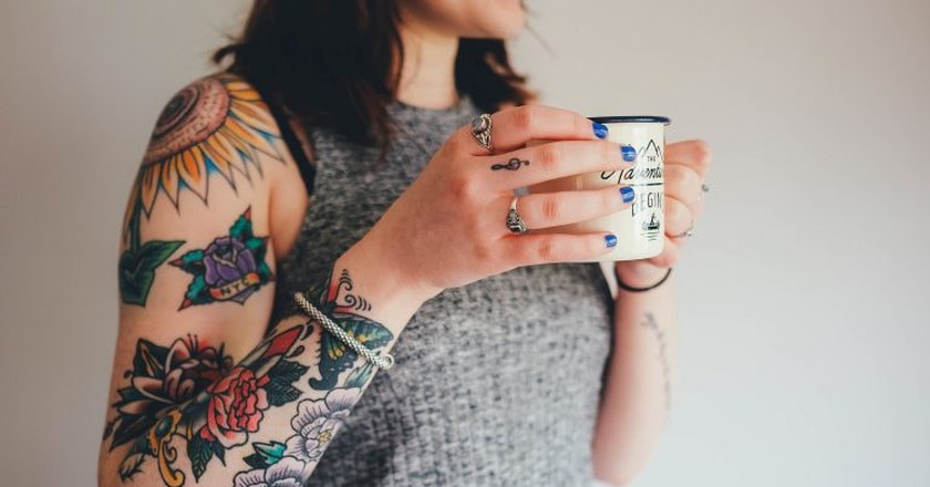 Striking colourful tattoos | © ThoroughlyReviewed / www.thoroughlyreviewed.com