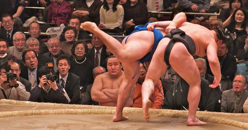 Two rikishi (wrestlers) competing in a bout   © davidgsteadman/Flickr