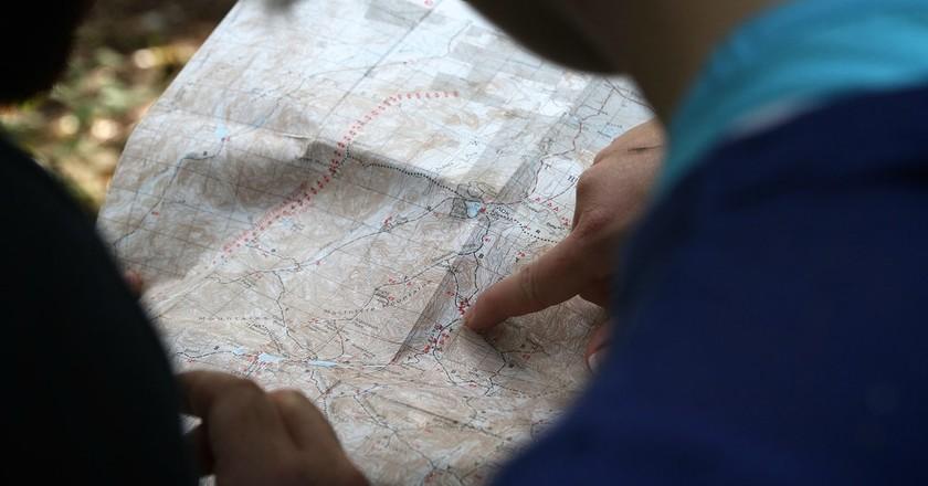 Studying the world map   © Free-Photos / Pixabay
