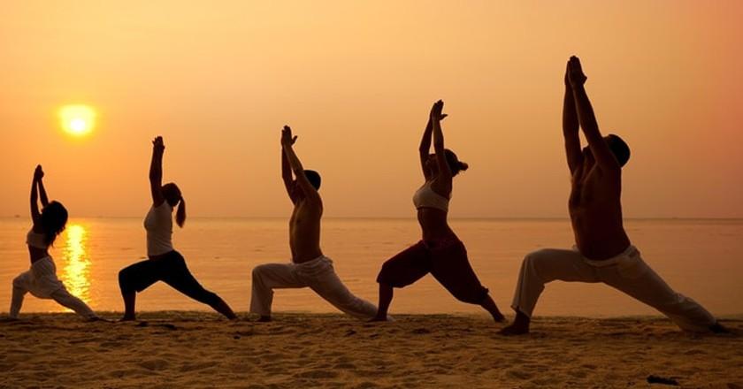 Beach yoga at sunset | Courtesy of Sailing Yoga Experience