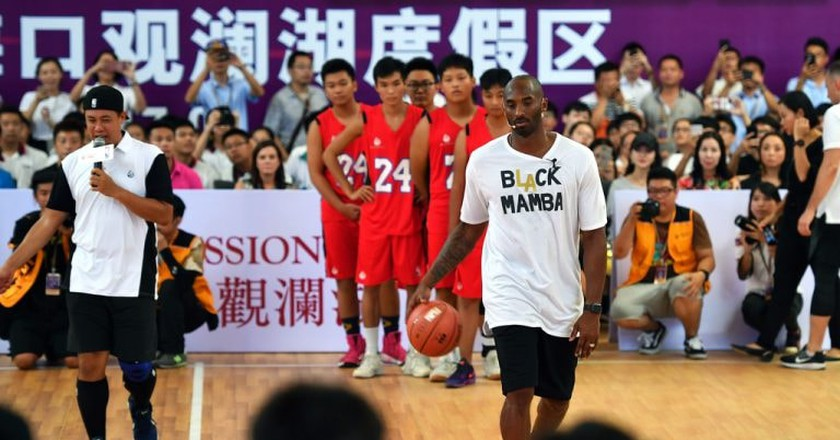 Former NBA player Kobe Bryant teaching basketball in China's Hainan Province | © Xinhua/REX/Shutterstock