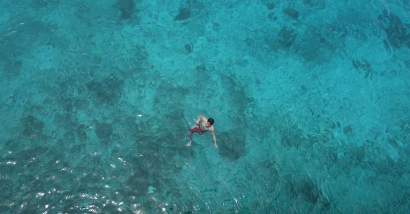 Man in sea, Siquijor, Philippines