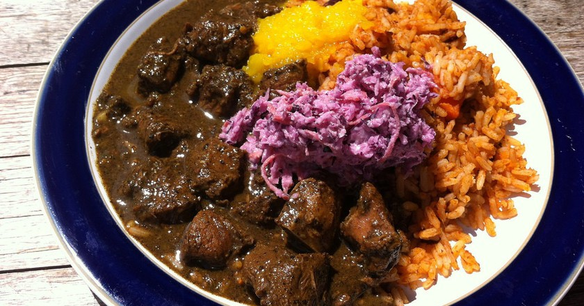 curry goat at fish wings and tings | © bob walker/Flickr