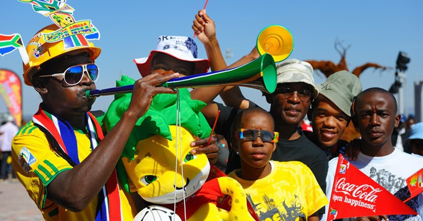 Soccer fan blows a Vuvuzela | © Coca-Cola South Africa / Flickr