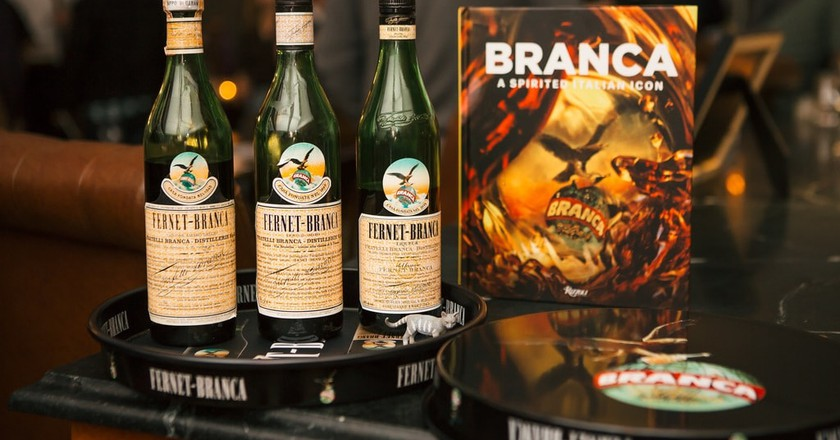 Bottles of Fernet-Branca along with a copy of the brand's new book   Courtesy of Fernet-Branca