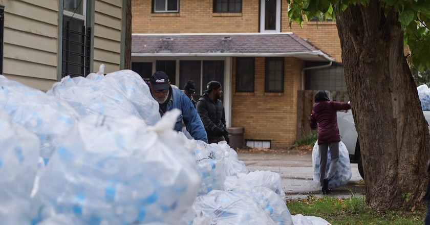 Flint residents collecting bottles for the Flint Fit project | Courtesy Ben Premeaux