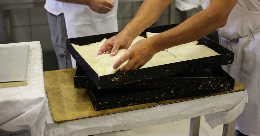 Bakers add the final touches before the bougatsa goes into the oven | © Eleni Philippou