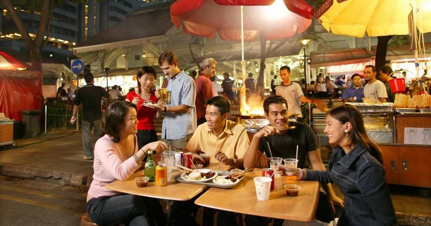 People eating satay at Lau Pa Sat