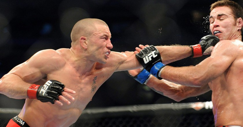 Georges St-Pierre (L) returns to the UFC octagon for the first time in nearly four years