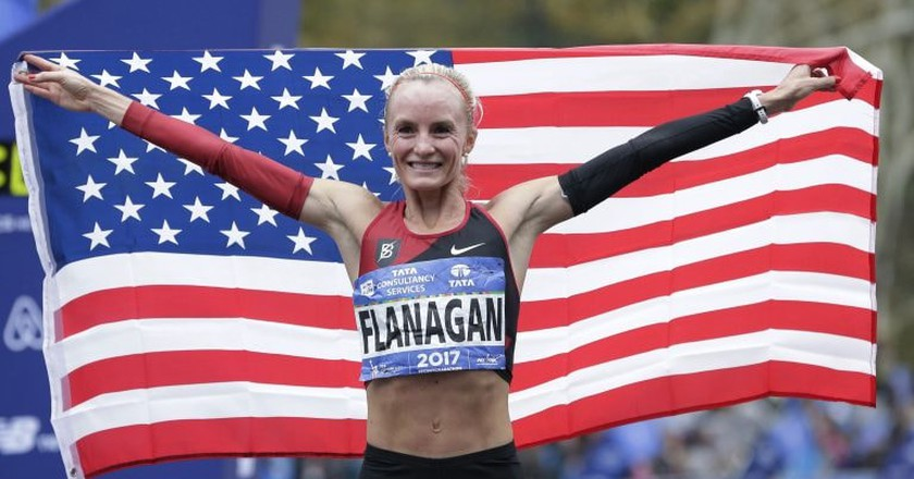 Shalane Flanagan celebrates winning the 2017 NYC Marathon | © AP/REX/Shutterstock